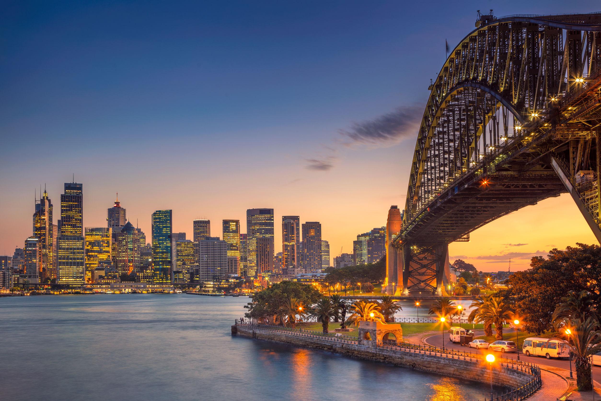 North ydney. cityscape image of sydney, australia with harbour bridge during summer sunset.